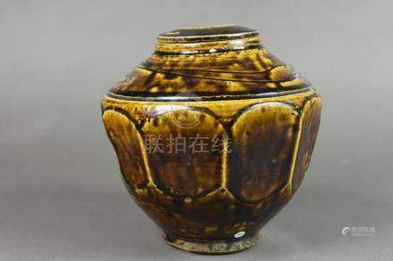 A Korean black-glazed honey jar