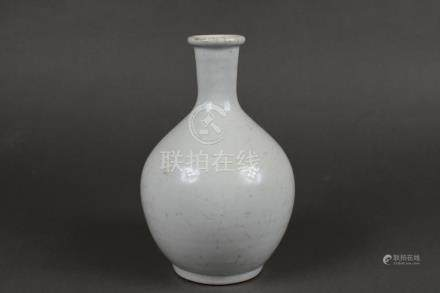 A white porcelain wine bottle
