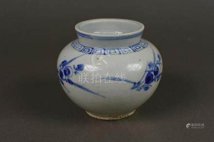 A blue and white porcelain jar with orchid design