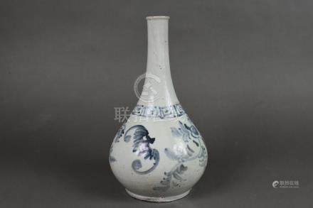 A blue and white porcelain wine bottle with bat design