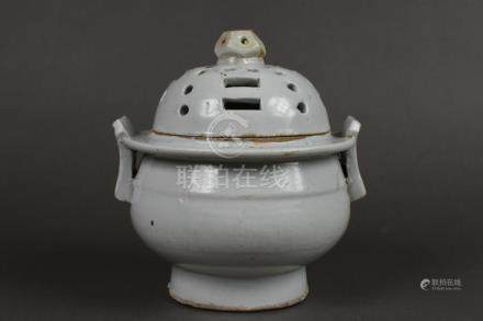 A white porcelain incense burner