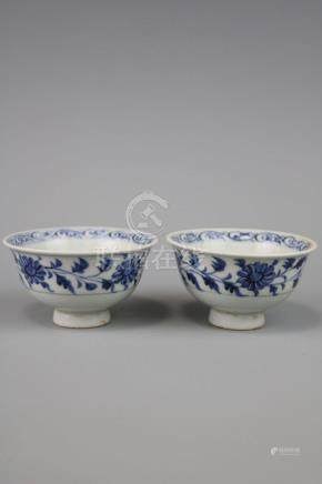 A Pair Of Blue And White Cups With Flower Pattern