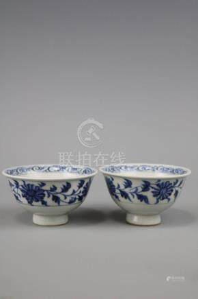 A Pair Of Blue And White Cups With Flame Pattern
