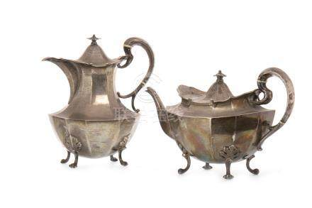 GEORGE V SILVER TEA AND COFFEE POTS maker R&W Sorley, Glasgow 1912, each of faceted baluster form,