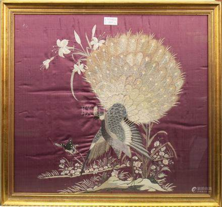 PAIR OF 20TH CENTURY CHINESE SILK EMBROIDERIES each depicting a single peacock amongst foliage, on a