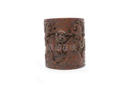 20TH CENTURY CHINESE BAMBOO BRUSH POT carved in relief with male figures and an elephant amongst
