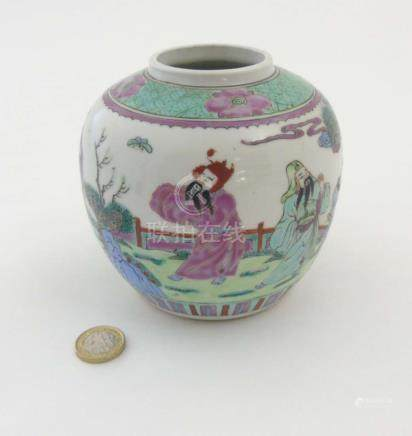 A Chinese Famille Verte ginger jar decorated in enamels of green, pink, purple and blue,