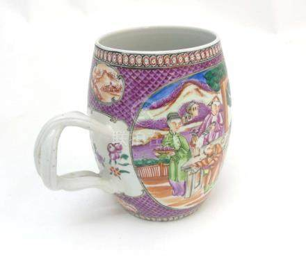 An 18thC Chinese export Mandarin tankard with twin handle,