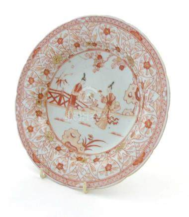 An 18th/19thC Chinese export plate depicting two oriental female figures to centre with trailing