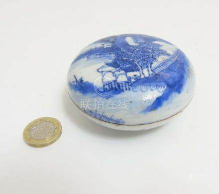 A Chinese circular blue and white lidded pot containing red ink paste,