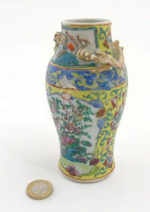A Chinese Cantonese famille jaune vase of baluster form,