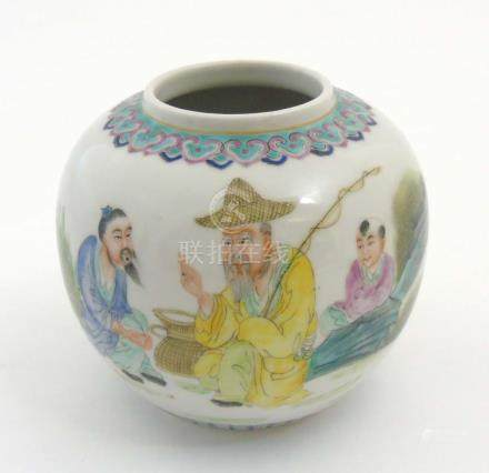 A Chinese Famille Verte ginger jar / pot, depicting a scene with three generations of men fishing,