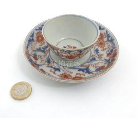 A Japanese Imari cup and saucer,