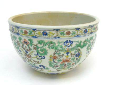 A Chinese Doucai jardiniere, with lotus scroll decoration across body,