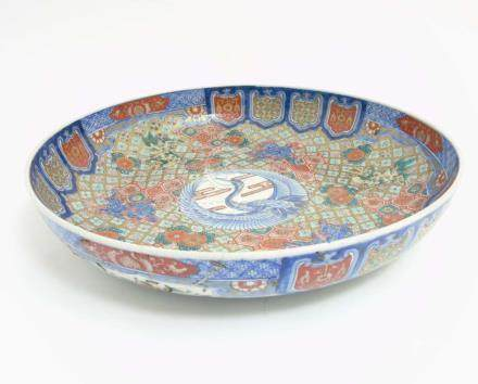 A Large Chinese bowl decorated in Imari style colours on a white ground,