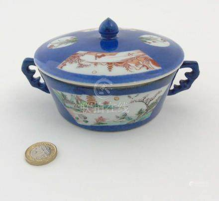 A Chinese pot and lid with handles,