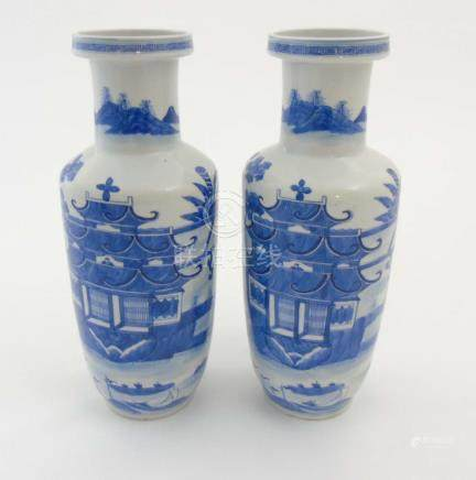 A pair of Chinese blue and white Rouleau vases,