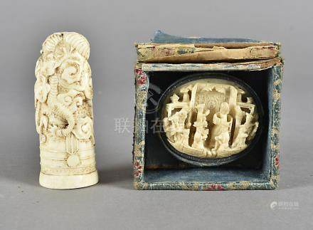 A 19th Century Chinese ivory carved cane handle, decorated with a dragon, 7.5 cm high together