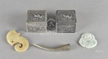 A pair of white metal Chinese hinged boxes, a Mauri style fish hook, Buddha pendant, finger nail