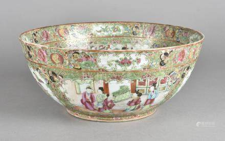 A 19th Century Chinese porcelain Canton punch bowl, decorated with figures within a landscape