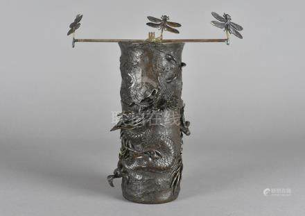 A Chinese bronzed sleeve vase, with relief decoration of three clawed dragon having light fitting to