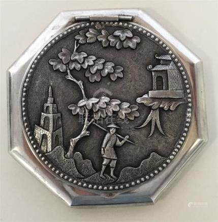 A heavy Chinese silver compact with figures under