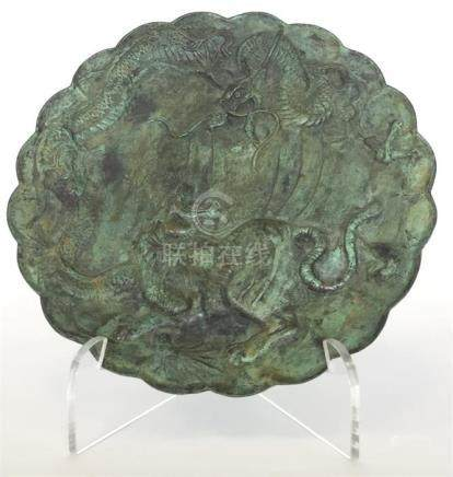 A Chinese bronze dish with shaped rim modelled wit