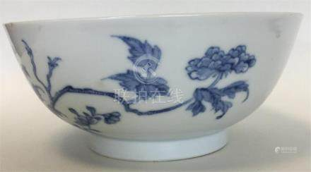 A Chinese porcelain blue and white bowl painted with flowering