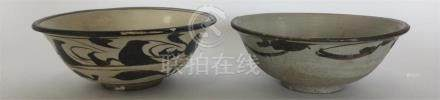 A Chinese Cizhou pottery bowl painted in dark and