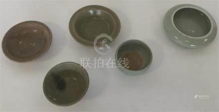 A Chinese porcelain Celadon-ground squat globular