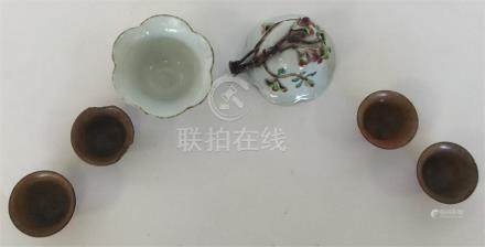 Four small brown-glazed pottery sake cups together
