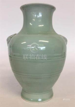 A Chinese celadon-ground oviform vase with moulded