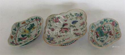 Three oval-shaped Chinese Famille Rose pedestal di