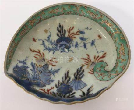 A Chinese oval shallow dish decorated with scallop
