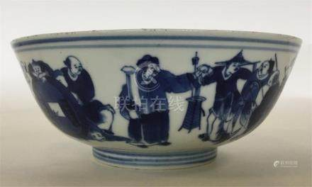 A Chinese blue and white shallow bowl decorated wi
