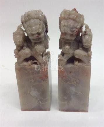 A pair of Chinese hard stone seals in the form of