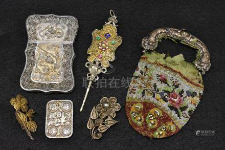 A Chinese silver filigree shaped rectangular visiting card case, Dragon and foliate decoration,