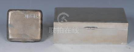 A Chinese silver rectangular cigarette box, hinged cover, sandalwood interior, 16.