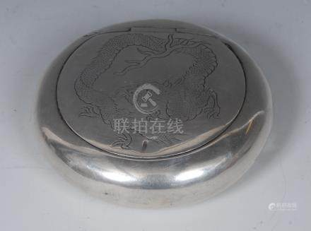 A Chinese silver circular snuff box, flush-hinged cover engraved with a dragon, 7.