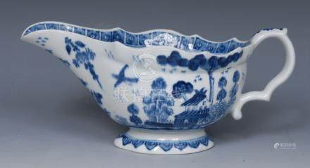 A Bow sauceboat, painted in underglaze blue with a house in Chinese landscape,