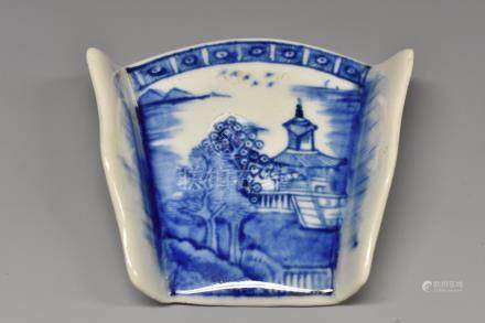 A Derby asparagus server, painted in underglaze blue with a Chinese landscape.