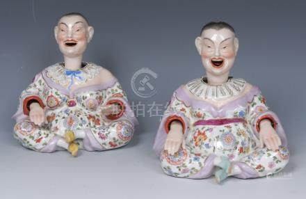 A pair of 19th century French porcelain nodding Chinese figures, both seated, wearing floral robes,