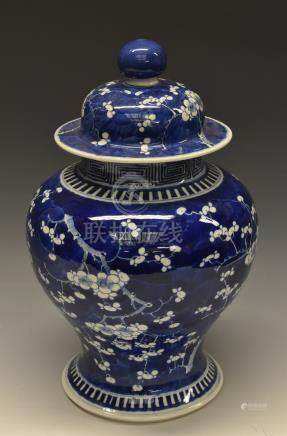 A 19th century Chinese inverted baluster jar and cover, painted with blossom in underglaze blue,