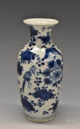 A 19th century Chinese porcelain baluster vase, painted with chrysanthemums, prunus,