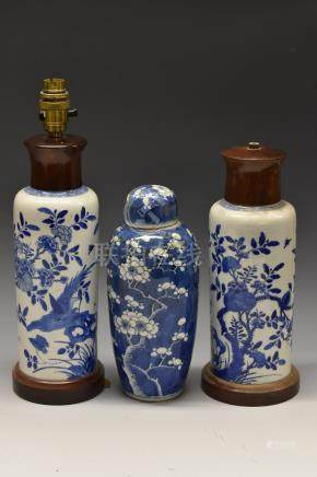 A Chinese blue and white slender ovoid vase, decorated with blossoming prunus branches, 28cm high,