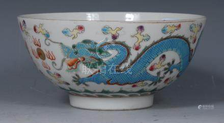 A Chinese bowl, decorated with Dragons chasing flaming pearls, stylised bats,