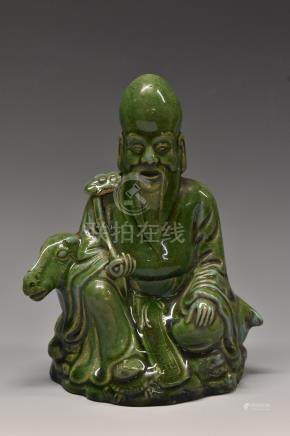 A Chinese figure, of Shou Lao, seated, beside a deer, holding a ruyi sceptre,