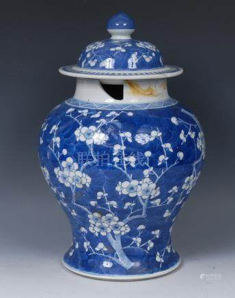 A Chinese ginger jar, decorated with blossoming prunus on a blue cracked ice ground, domed cover,