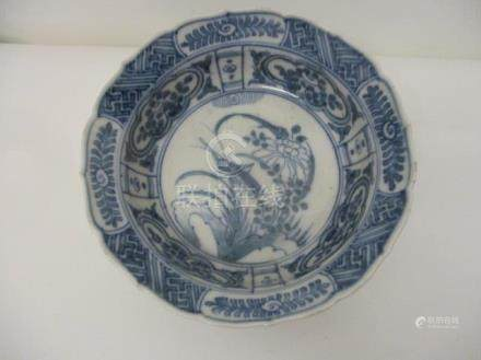 A 19th century, possibly Chinese blue and white bowl decorated with a cricket and flowers and panels