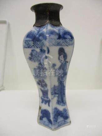 A Kangxi Chinese blue and white perfume bottle of waisted, inverted hexagonal form, decorated with